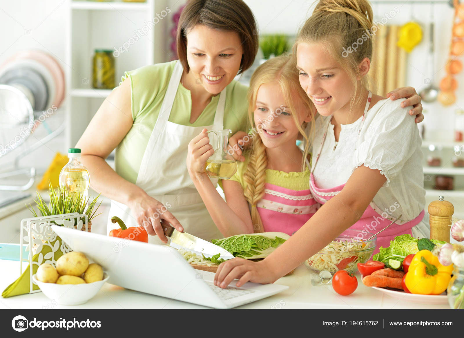 Mother And Two Daughters Cooking Stock Photo Image By C Aletia 194615762