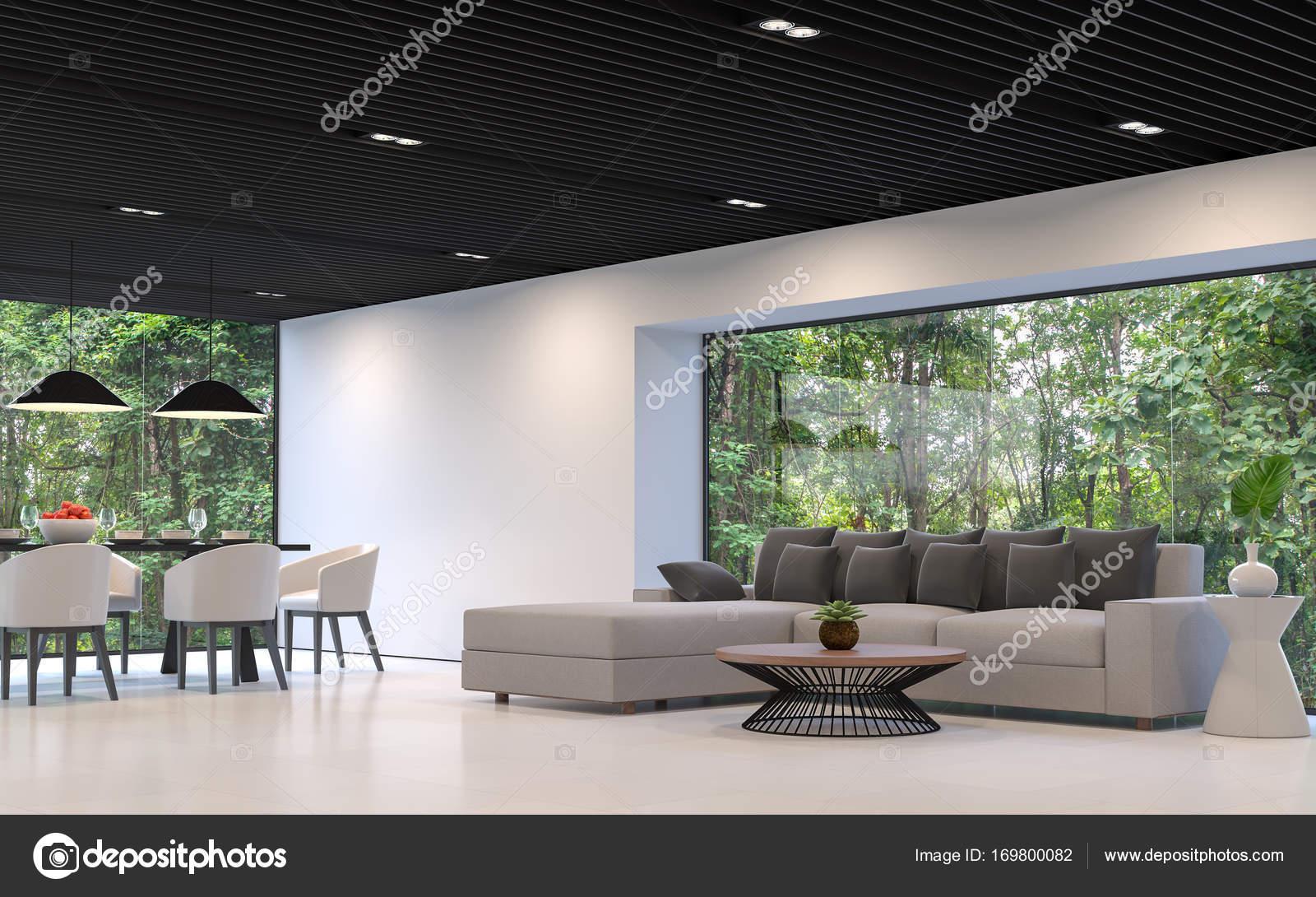 Moderne woonkamer en eetkamer met uitzicht op de natuur
