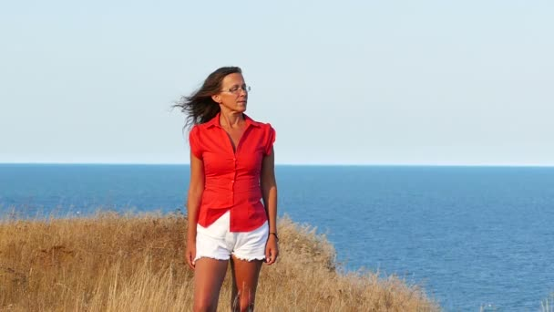 a9c0aaa048c Slow motion. Adult woman in red and sea