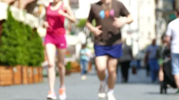 4K .Healthy lifestyle of  unknown people on European city street. Blurred scene