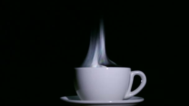 White cup of tea or coffee  with steam on  black background. 4K