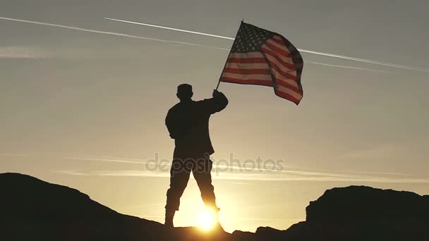 Soldier silhouette and American Flag in Slow Motion.