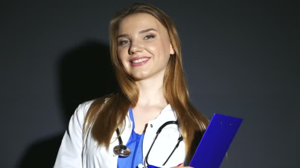 4K.Face of Medical nurse doctor woman with clipboard looking at camera.