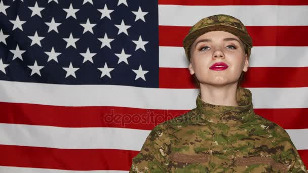 Smiling young girl  soldiers  with makeup in front of US flag