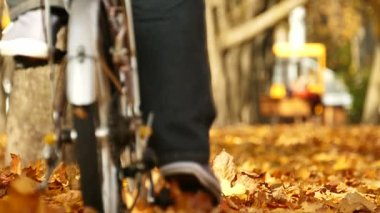 Slow motion .Bicycle in autumn city park with trees. Healthy life
