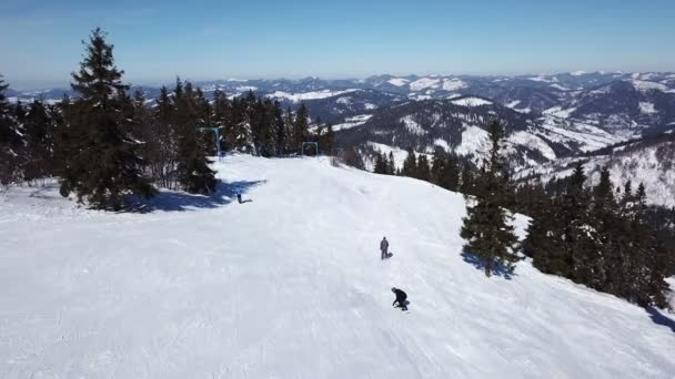 Aerial. Mountain skiers silhouettes. Winter ski rest time.