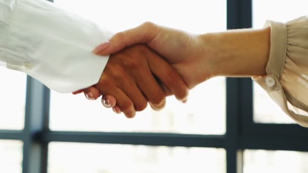 Two business partner woman, shake hands when meeting.  Slow motion