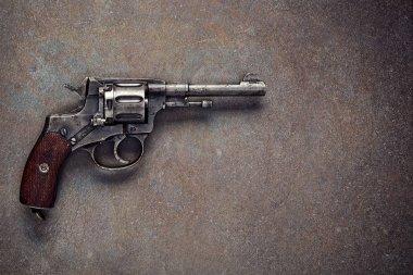 Old revolver on  vintage dark background. stock vector