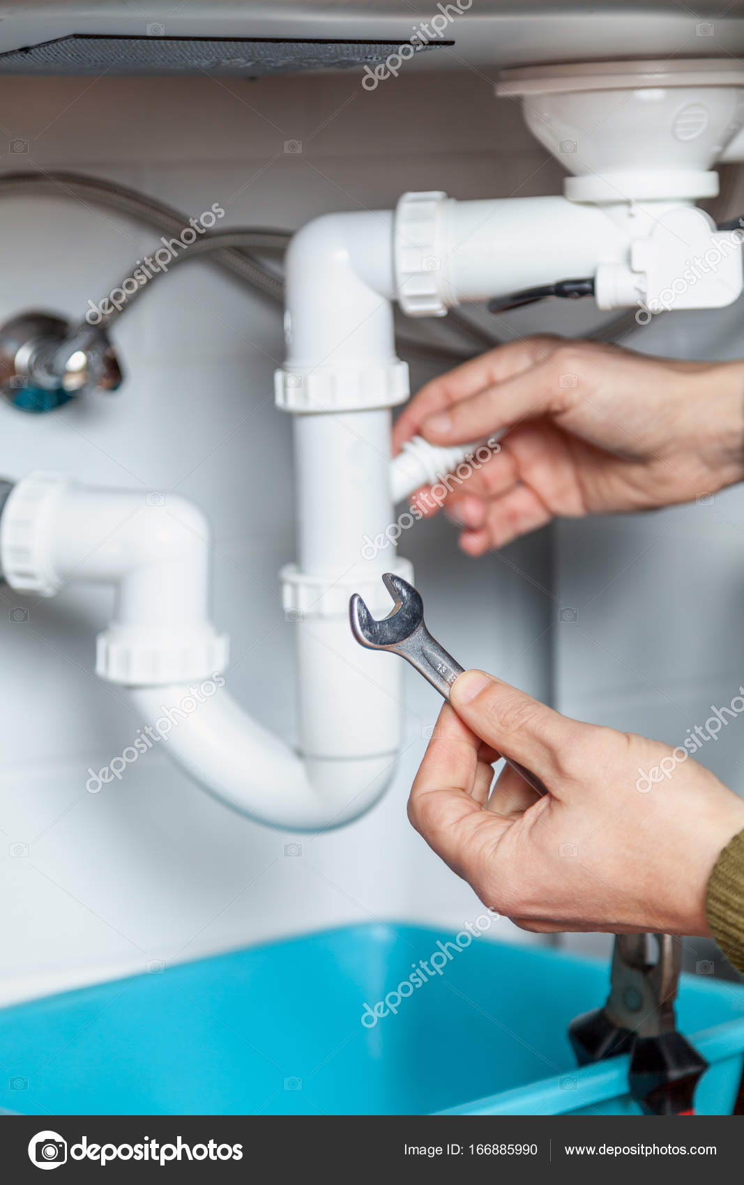Repair of kitchen weir with wrench — Stock Photo © glebchik #166885990