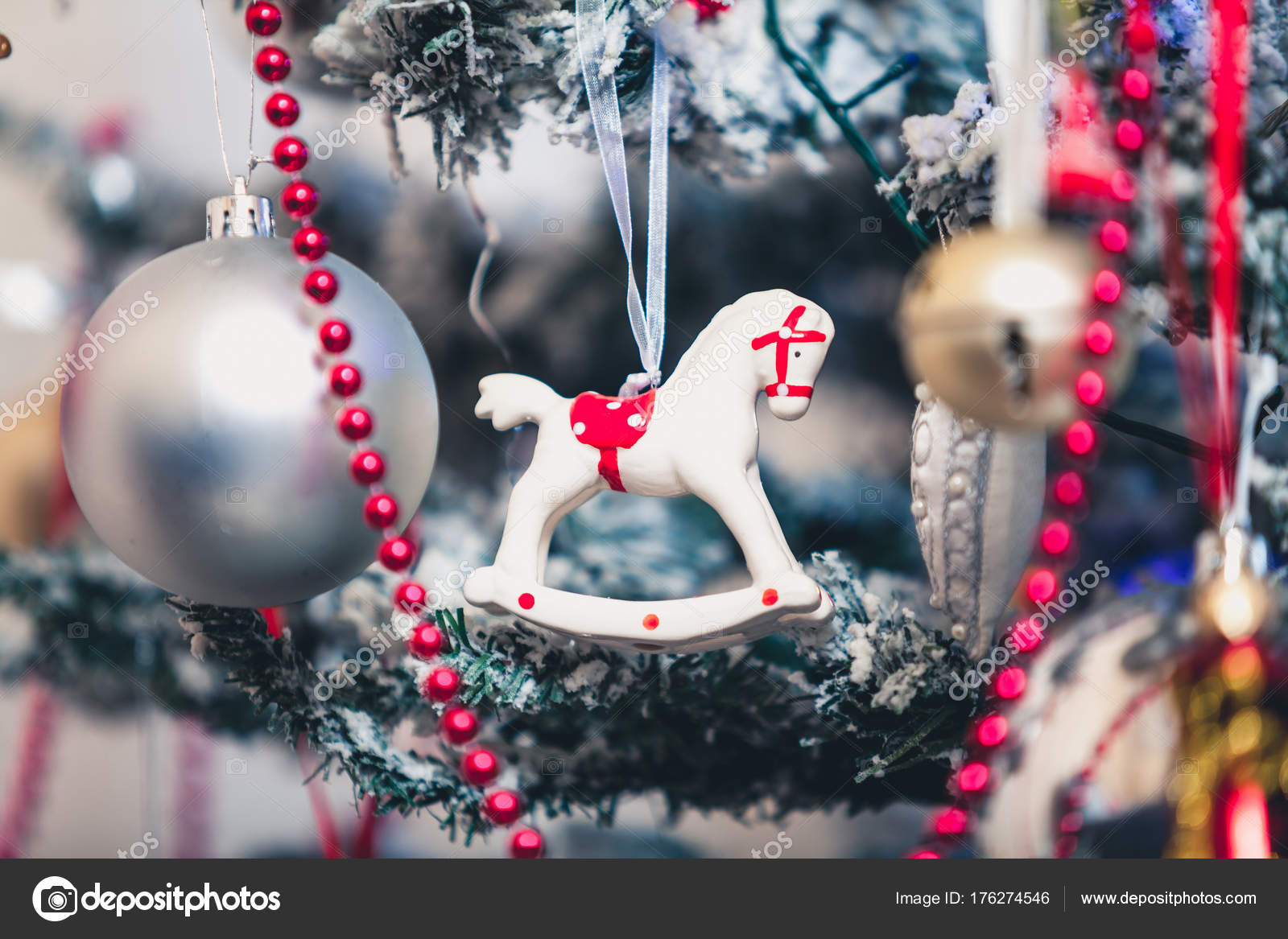 White porcelain horse on Christmas tree — Stock Photo