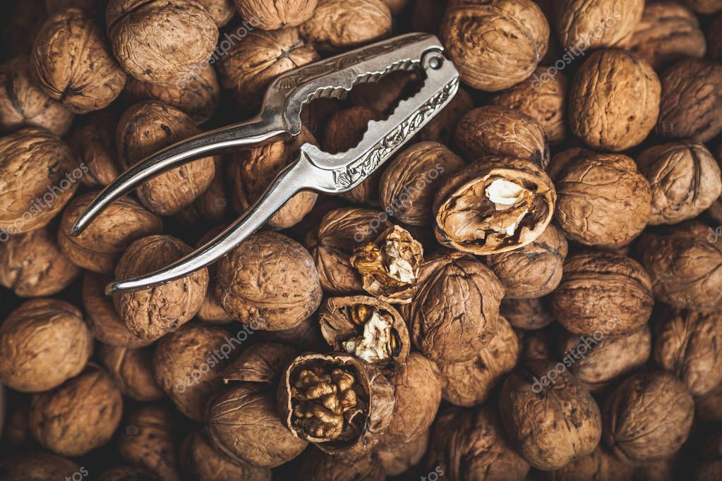 group of large walnuts and pincers