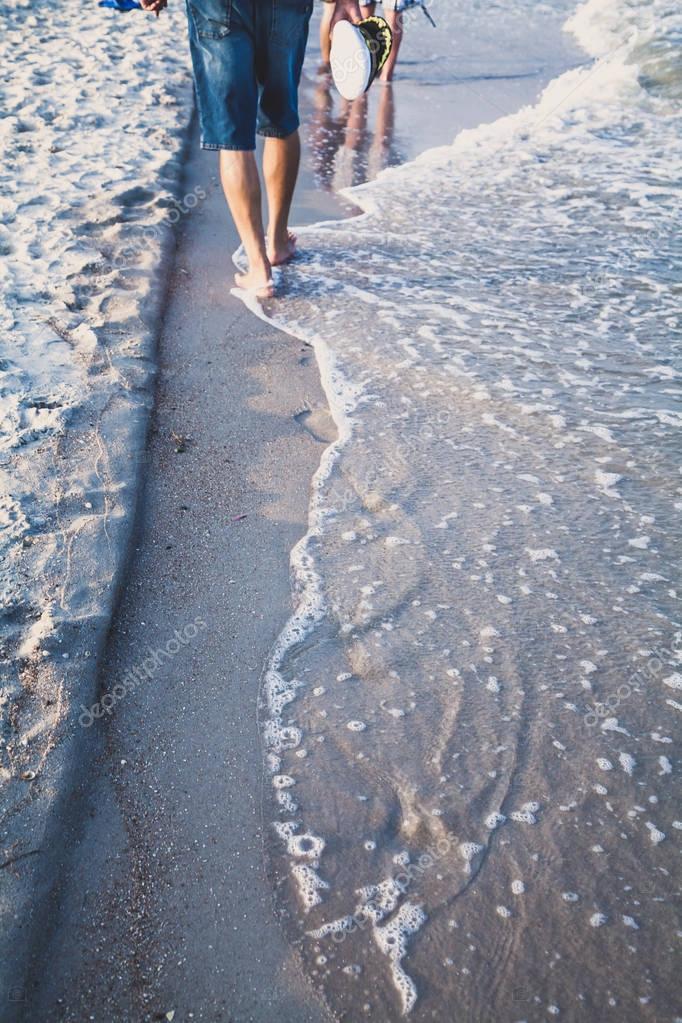 Man walks on the sea beach