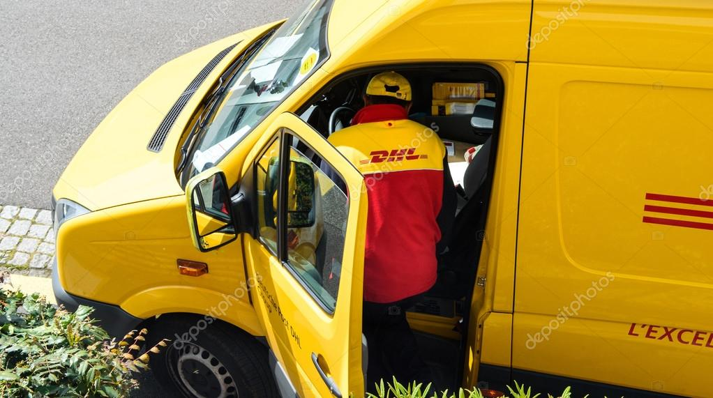DHL yellow delivery van driver above – Stock Editorial Photo ...
