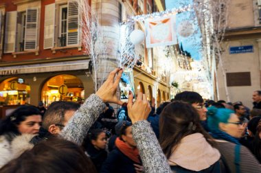 Photographing Christmas Street with cameras and mobile phone
