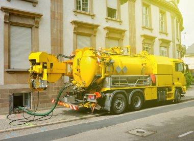 Working Sewage truck working in urban city environment