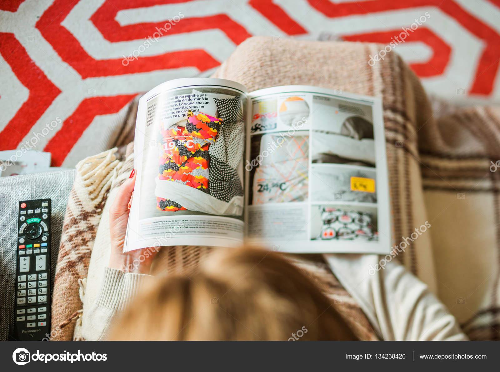 woman reading ikea catalog furnishing house u stock photo
