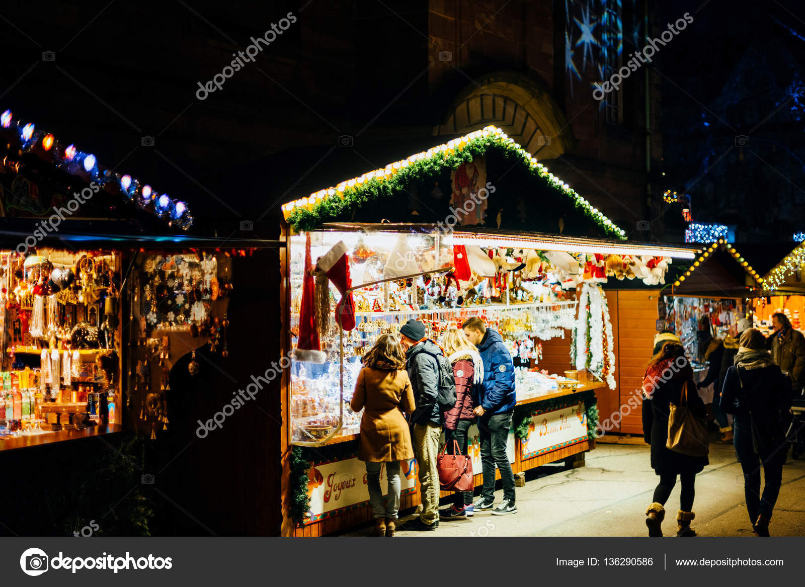 buying christmas toys in strasbourg christmas market stock photo