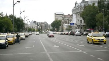 Cars, trolleybuses and pedestrians