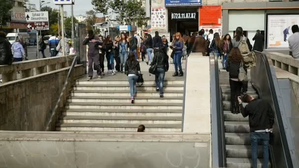 People exiting crowded metro station