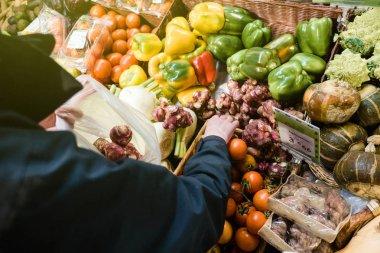 Woman buying at vegetable market the fresh  organic bio fresh Je