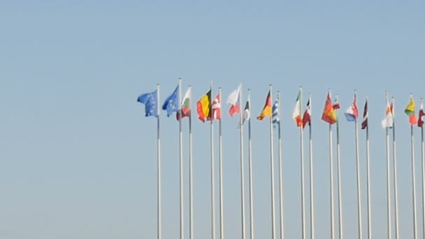 close-up of flags on blue sky background