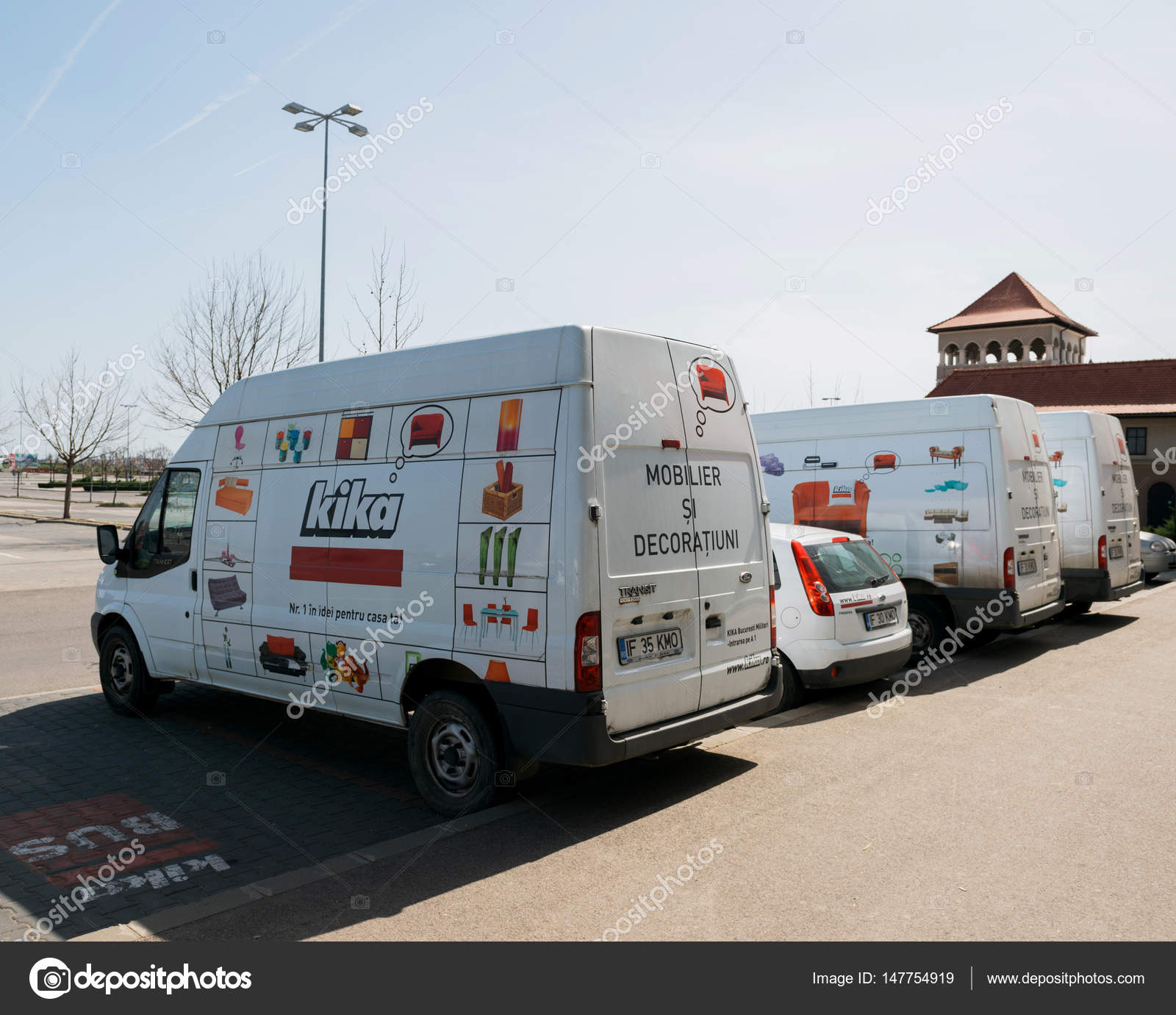 dab9c4f9899b75 Row of white vans parked in front of Furniture store KIKA – Stock ...