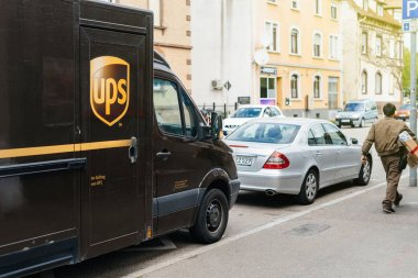 UPS United Parcel Service delivery van with worker driver
