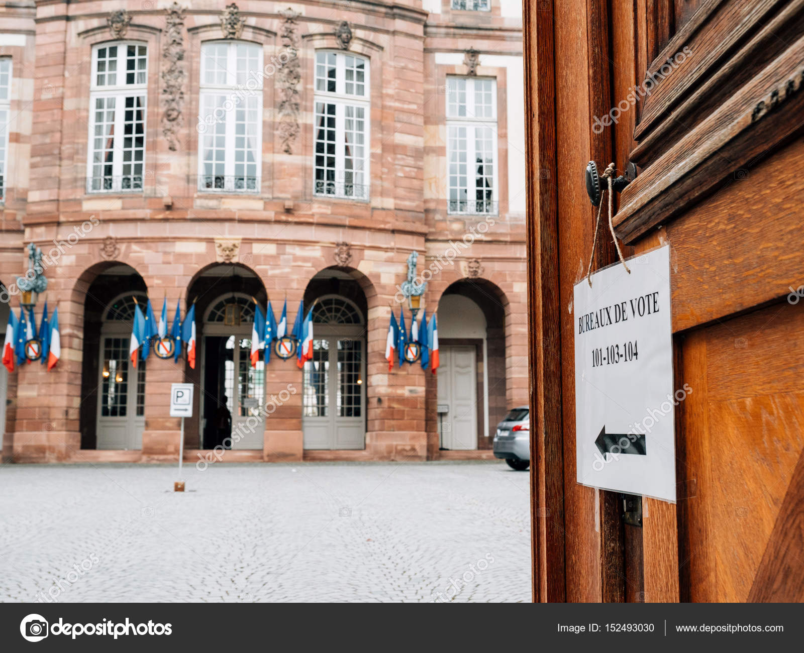 Bureau de vote polling station french city hall with flags in