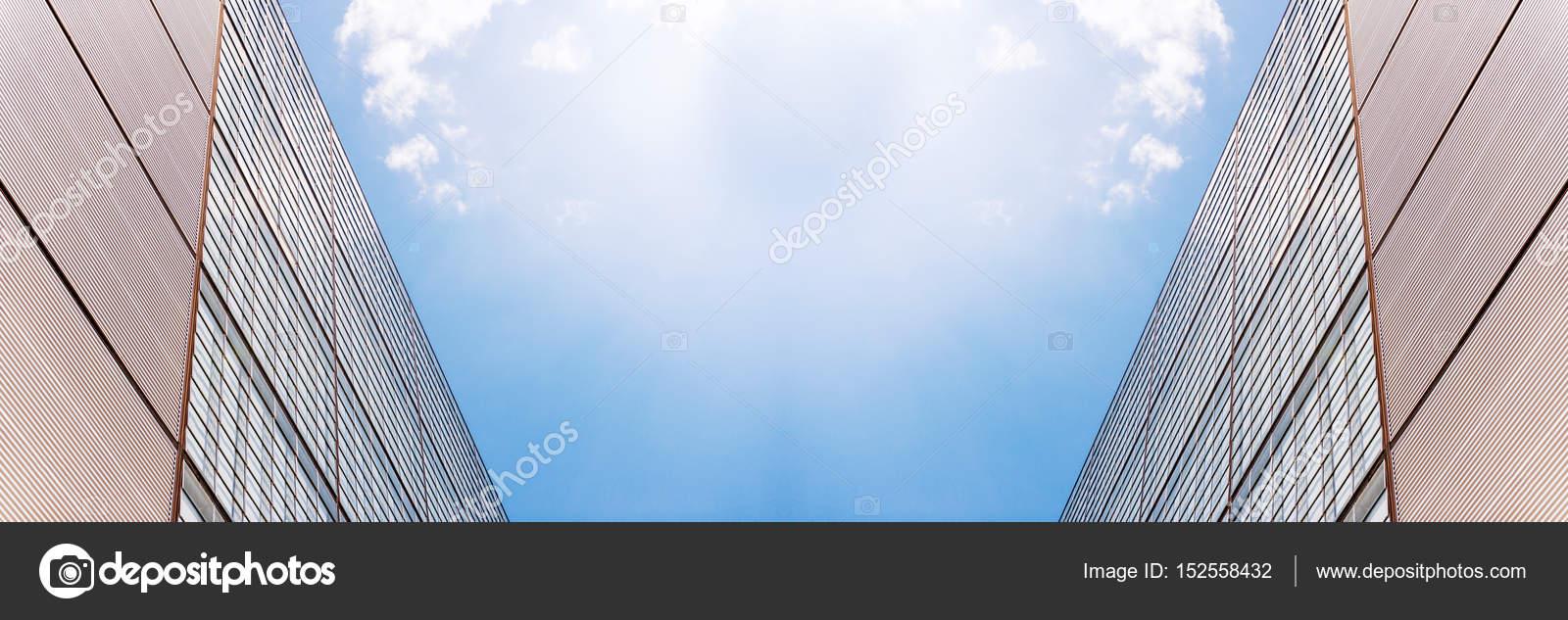 modern office building vide with sun flare sunbeam stock photo