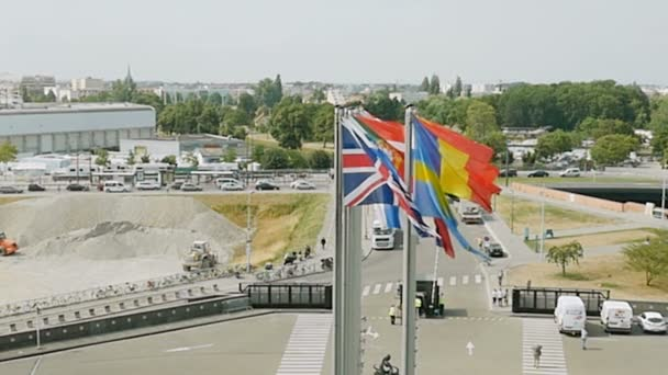 Flags waving in front of the European Parliament