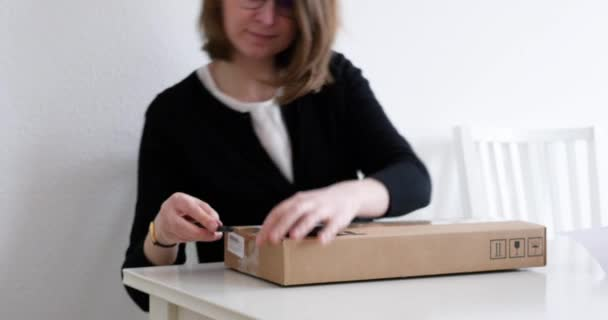 Woman unboxing video card