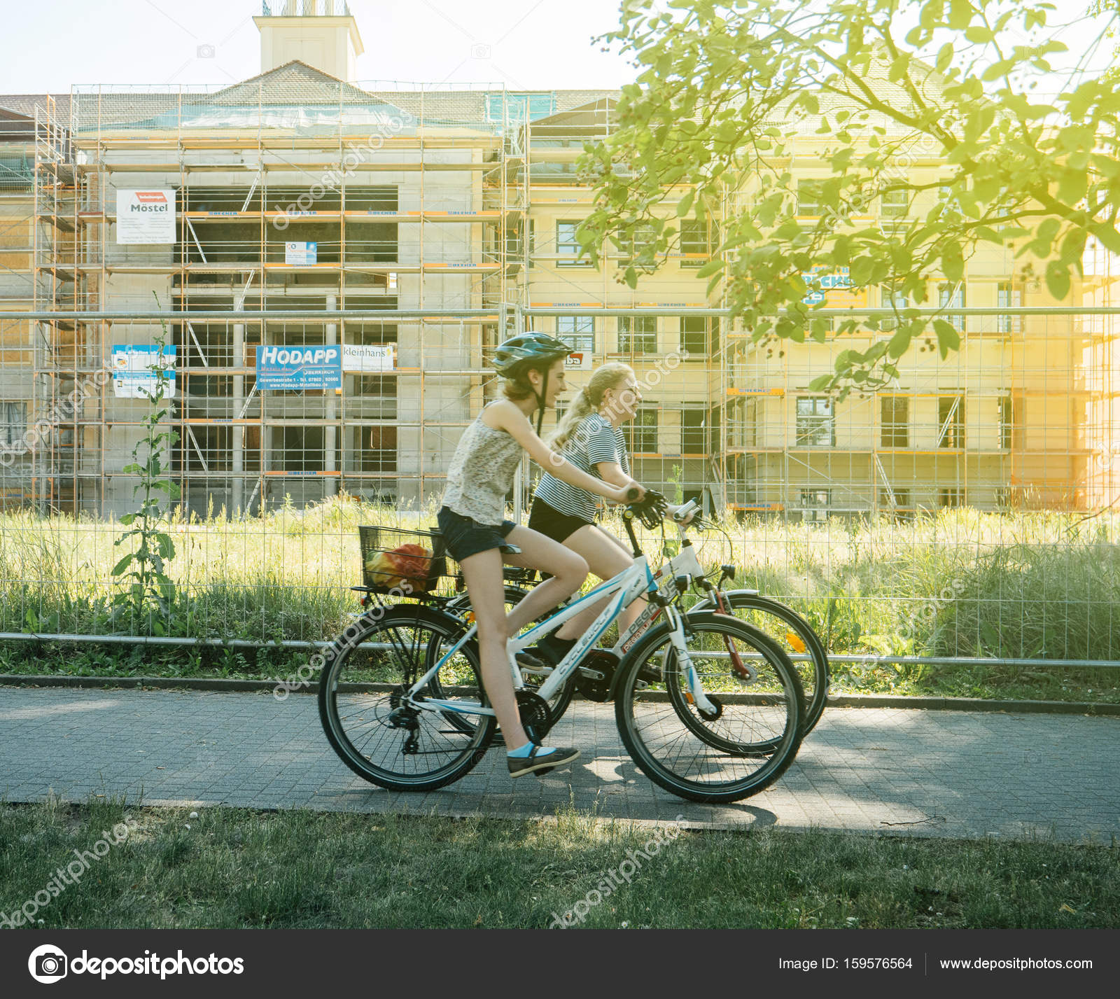 German Young Women Bikes City Street – Stock Editorial Photo