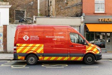 Incident response unite red van parked on london street
