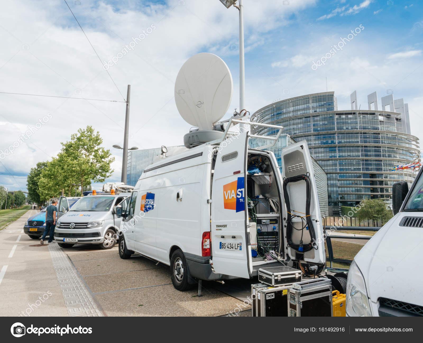Engineer near Media TV truck van parked in front of