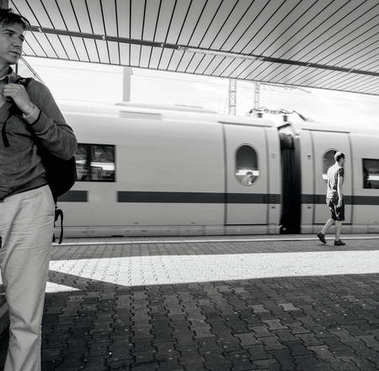 Hansom man waiting for the train in Germany