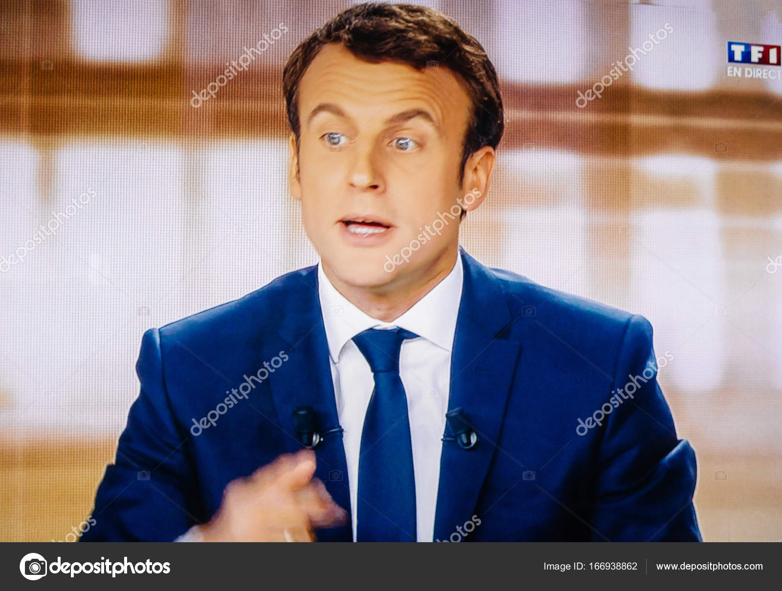 Emmanuel Macron debating live at French television with Marine Le