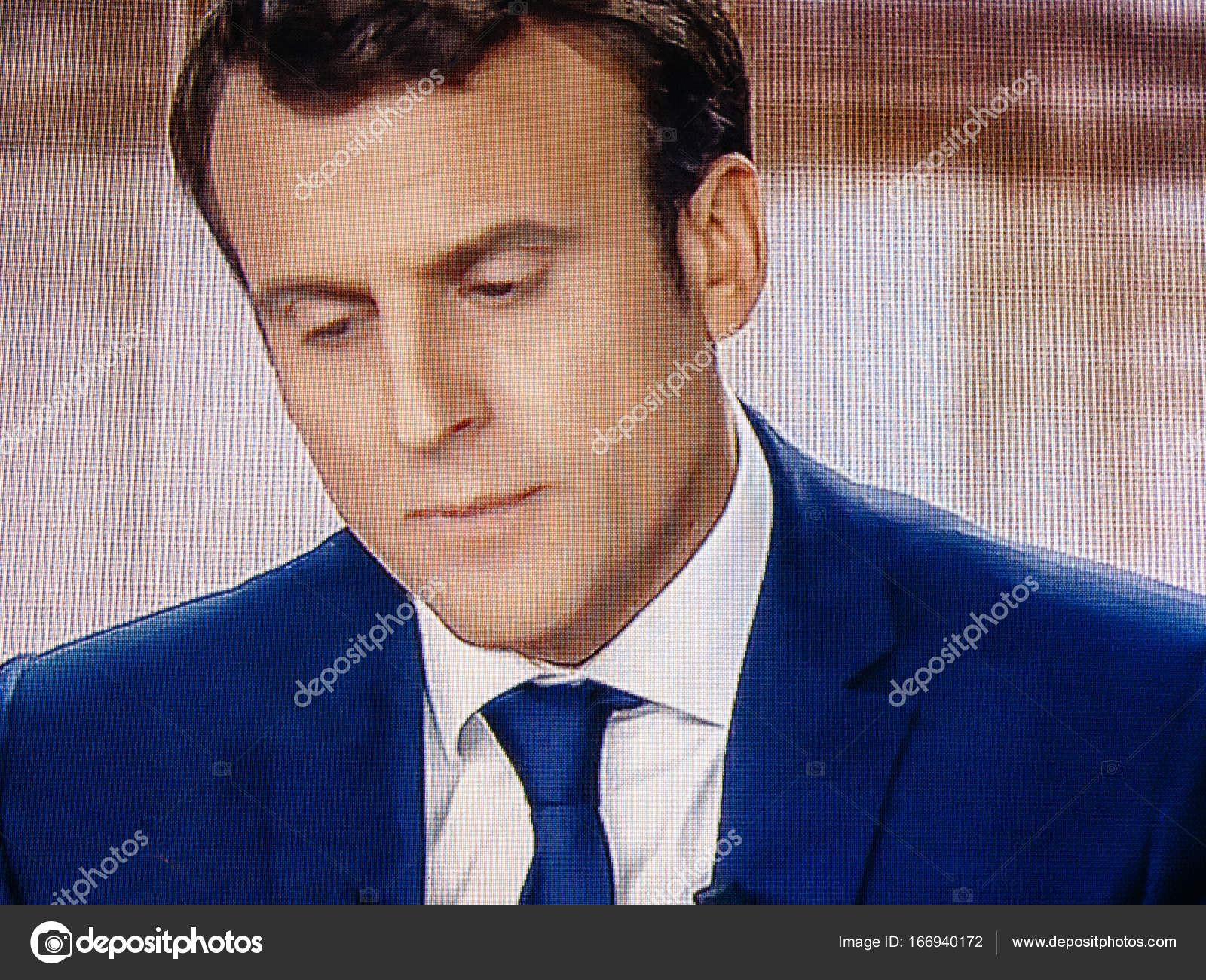 Emmanuel Macro debating live at French television with Marine Le