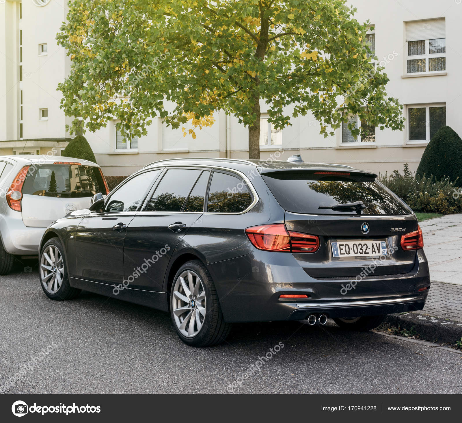 Rear View Of BMW 320d Wagon Luxury Car Parked