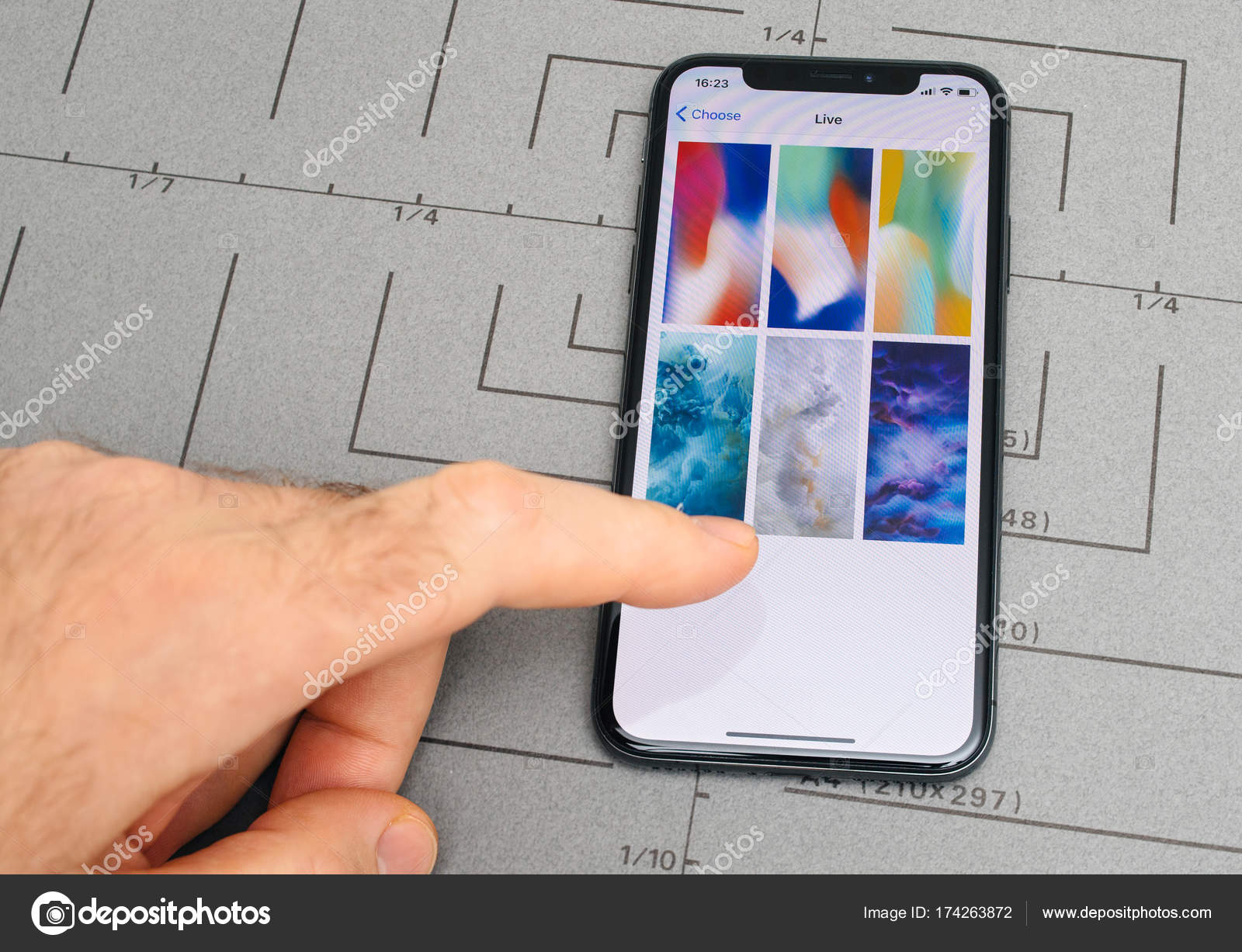 PARIS, FRANCE - NOV 9, 2017: Male hand touch selecting New Apple iPhone X 10 smartphone screen after unboxing and selecting live wallpaper — Photo by ...