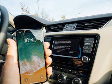 Man Connecting to Apple cArPlay the new iphone X 10 by Apple