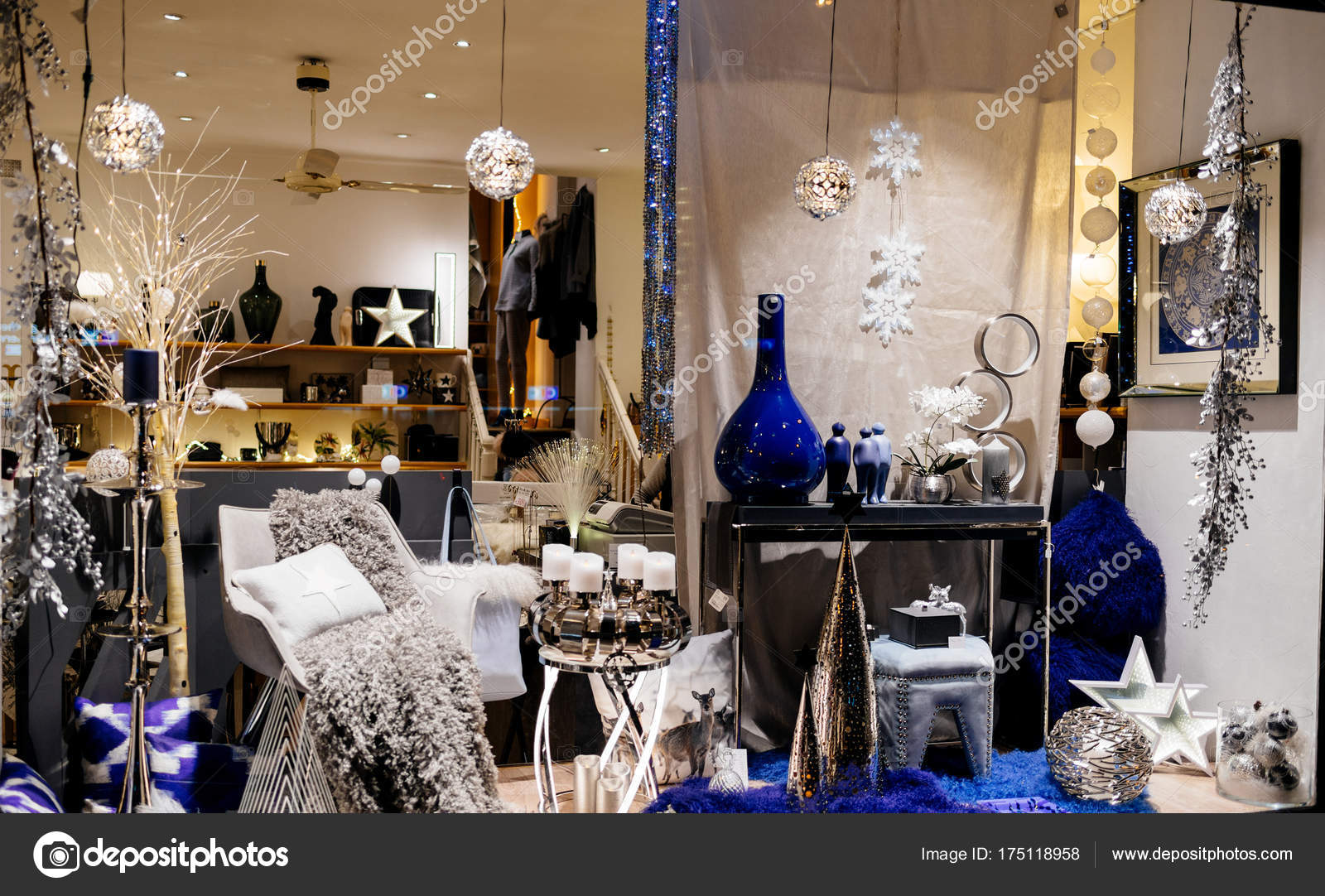 Christmas decorations in store window showcase of a floral show pin Strasbourg, France with multiple colorful globes, vases and toys — Photo by ifeelstock