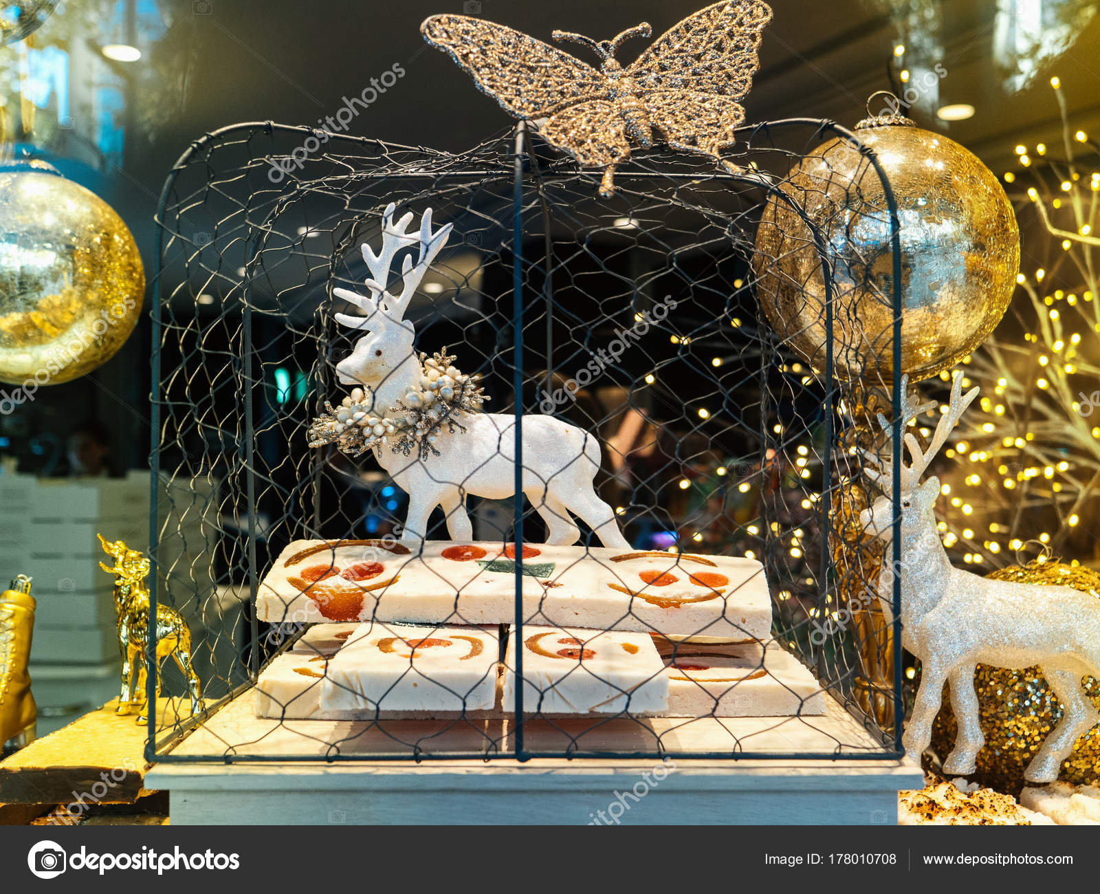beautiful traditional christmas decorations of spanish bakery selling tartes and cakes with diverse figurines of reindeers santa and other characters