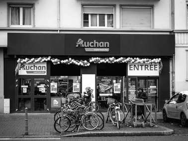 Auchan Supermarket entrance in French neighborhood on a winter s