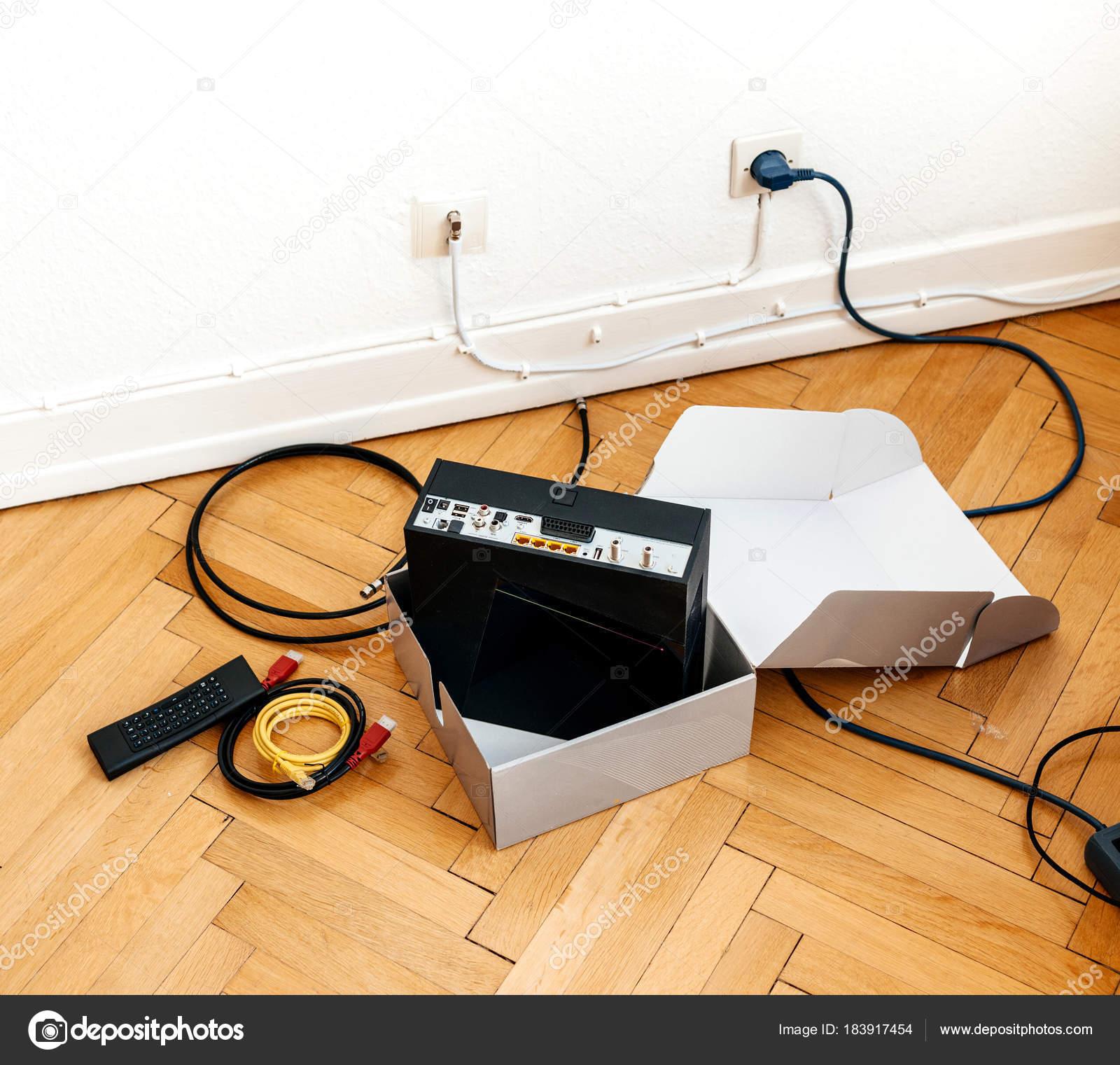 Installation of cable internet provider modem set-box — Stock Photo