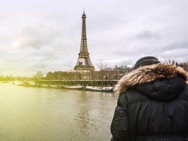 Parisian French man watching the flooding swollen Seine river
