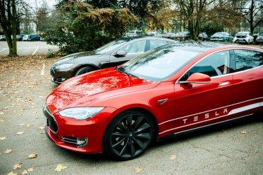 Overhead shot of new red and gray Tesla Model S showroom