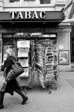 Woman walking in front of French press kiosk Stephen Hawking dea