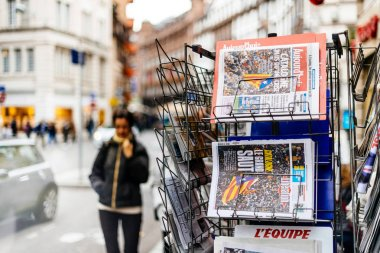 Pedestrians next to news from Spain about the Catalonia Referend