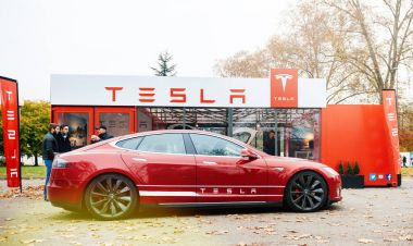 New Tesla Model S showroom parked in front of the red showroom