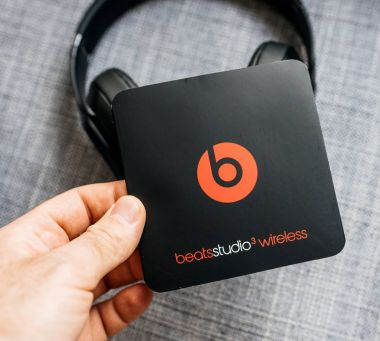 PARIS, FRANCE - MAR 31, 2018: Man unboxing new Apple Beats By Dr Dre Beats Studio 3 Wireless headphones with Pure Adaptive Noise Canceling Pure ANC - holding instruction manual
